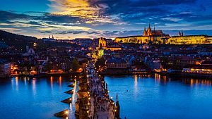 Panorama of illuminated Prague castle and Charles Bridge with to