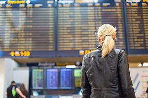 Female-traveller-checking-flig-93626168