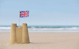 CTR1JW  Union Jack flag in a sandcastle on a beach. Wells next the sea. Norfolk, England beach_3085044b.jpg