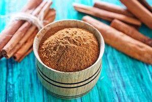 cinnamon sticks on the wooden table, cinnamon in bowl