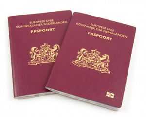 Two Dutch passport isolated on white background