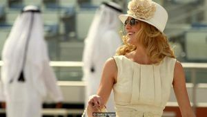 A guest arrives at the Meydan race track before the start of the Dubai World Cup, the world